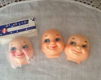 """Vintage, Plastic Celluloid-like, doll faces, 3"""" side glance eyes, pink cheeks, 3 faces"""