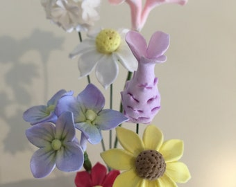 Clay flowers - 7 small mixed handmade deco clay flowers in a paper vase