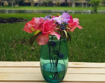 Small silk floral arrangment in green glass