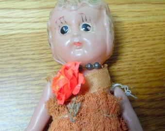 Really old, Carnival prize plastic doll.  I would guess that she is from the 1930-40s, but she is not dated
