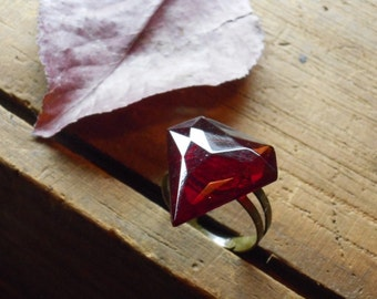 The Superhero Nostalgic Ring. Vintage Upcycled Red Glass Super Manly crest and silvertone  ring.
