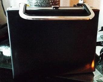 Chic Vintage Handbag is Black with Silver Metal