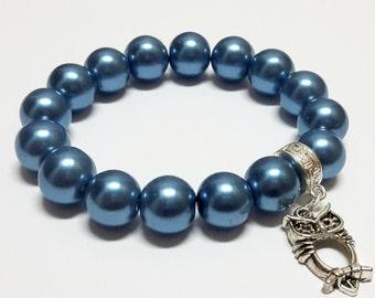 Owl in blue bracelet