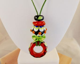 Orange, green and black artisan made glass bead necklace on leather cord