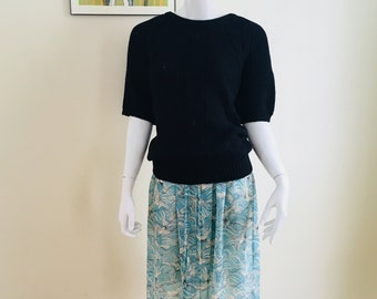 Sheer crane skirt and vintage black knit sweater top with cropped sleeves