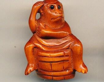 Boxwood Button -Monkey on a Barrel