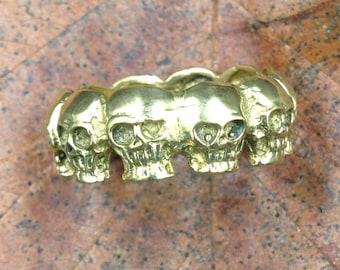 Skulls faces brass ring