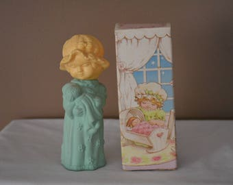 Avon Sweet Dreams little girl decanter filled with 1.25 fl. oz of Sweet Honesty cologne