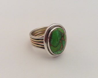 sterling silver tri-metal ring with green turquoise cabochon