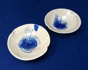 Small snack plates or bowls. Contemporary ceramics. White and blue. Appetizer bowls or plates.