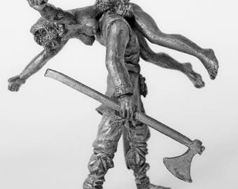 Tin soldier. Tin miniature. Pewter sculpture. Vikings. Viking with booty. The scale is 1/32.