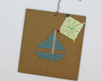 Embroidery Kit for kids on a cork board, boat