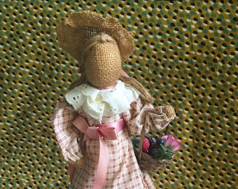 girl with a basket-vintage doll