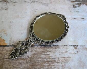 Vintage hand mirror.Nickel silver embossed hand mirror.round mirror.Greek memorabilia.Bas Relief Hand mirror.Gifr for her.Item from 60's.