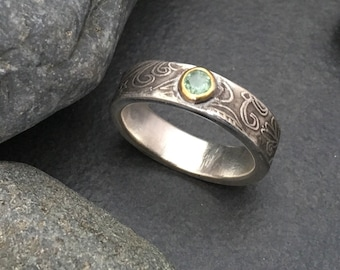 Pale green tourmaline ring, thick sterling silver band, 22 karat gold bezel, delicate flowing sky celestial design, fits about size 9.5