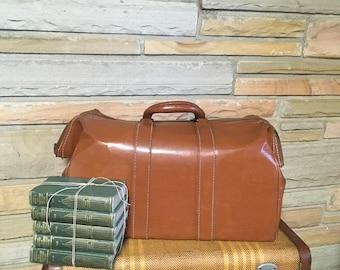 Vintage duffle bag travel bag carryon luggage office brown leather handles vinyl decor doctor retro mid century storage case bag makeup