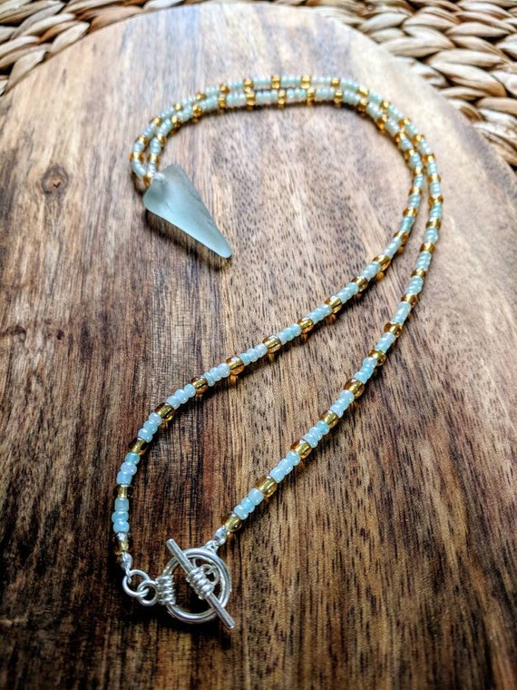 Sea glass beaded necklace // bohemian // blue and gold // vintage glass // unique