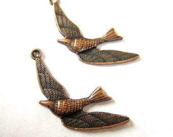 10 bird charms antique copper swallows 35mm x 28mm