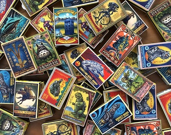 ChetArt Matchboxes- Eight matchboxes with pop culture labels for 15 dollars