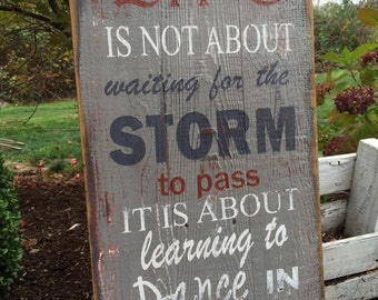 Life is not about waiting for the storm to pass RUSTIC wood PAINTED sign