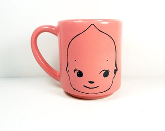 15oz coffee mug/tea mug with giant Kewpie head on both sides, shown here in Bubblegum glaze. READY TO SHIP