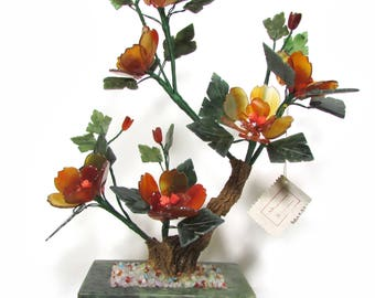 Plant with flowers in carnelian coral and Jade
