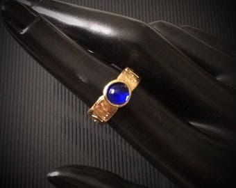 Rune gold plated pewter ring, adjustable and with blue stone