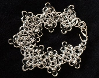 Unusual Celtic/Japanese Chainmaile Bracelet with Bright Aluminum and Black Anodized Aluminum. Sterling clasp.
