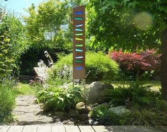 wood and glass garden sculpture