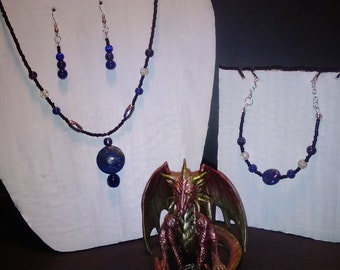 A blue, black and steel 4 piece set including necklace, earrings, bracelet and ring