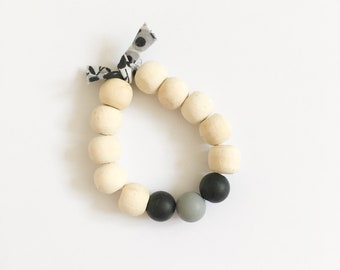 Black and gray baby-child bracelet with its liberty winter morning
