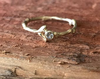 Twig with white sapphire ring in 14k yellow gold