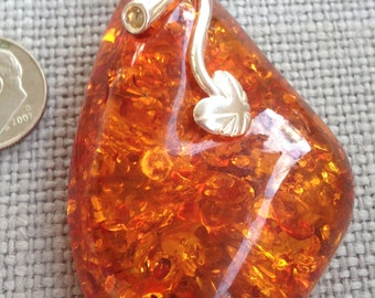 vintage large Baltic Amber cabochon in Sterling Silver frame Pendant hallmarked 925. circa 1970's.