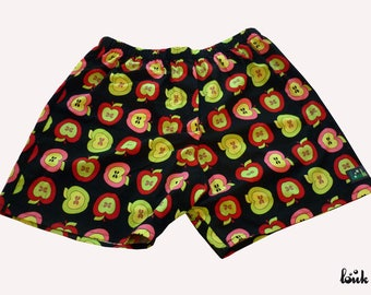 Black and lime green patterned apples man pants
