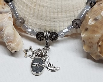 "Beaded choker style necklace. Moon, star and ""imagine""charms 15 1/2"""