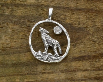 Sterling Silver Wolf Pendant Howling at the Silver Moon, detailed on both sides to show off the wolves magnificence.