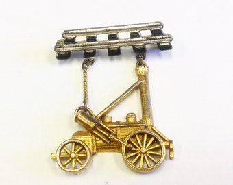 Vintage, Stephenson's Rocket steam locomotive engine brooch or badge. Novelty train enthusiasts pin.