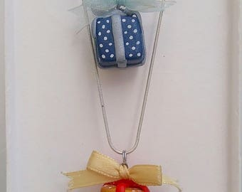 Shaped in polymer clay gift necklace.