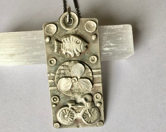 new fish/clover/bicycle pendant in sterling