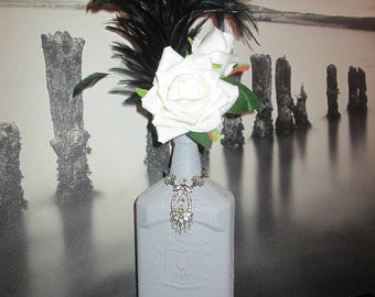 Glass bottle, vase, decorative object, grey with pink concrete effect white and black feathers