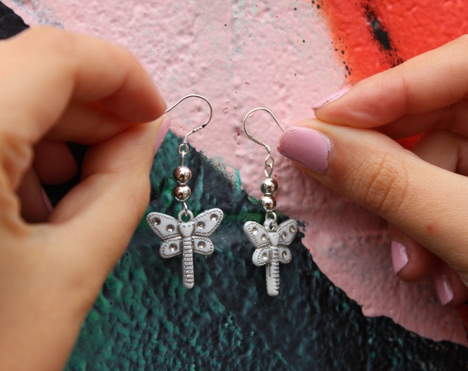 Silver and White Dragonfly Beaded Earrings.