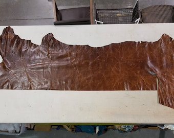 Large remnant of distressed leather in brown
