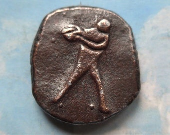 Sporting button, metal, vintage.   A sportsman about to throw a ball, white heavy metal, thick copper col. paint, wedge shank. c1940's.