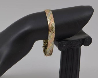 """14k Tricolor Gold Bracelet with hinged segments Circa 1960 , 7.25"""" long"""