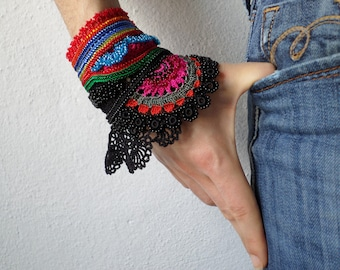 freeform crochet cuff bracelet with pink, red, blue beaded crochet flowers and black crochet lace