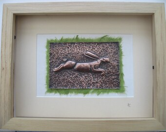 Copper repousse running hare in natural wood frame