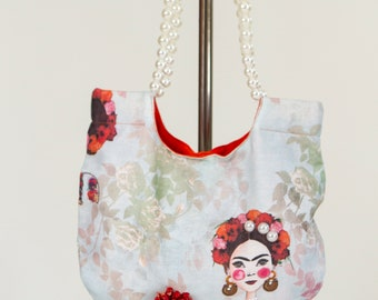 Frida stamped handbag with pearl handle