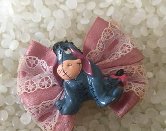 vintage barrette , 1995 , eyeore, Disney  plastic and ribbon, colorful plastic eyeore