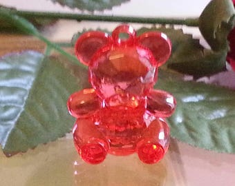 1 pendant in transparent acrylic, medium, red, about 42 mm long, 32 mm wide, 23 mm thick, hole: 3