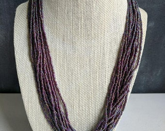Purple multi- strand necklace